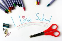 I Love School. A sign saying I Love School with wax crayons and scissors Royalty Free Stock Images