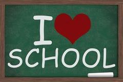 I love school. I heart, love school  written on a chalkboard with a piece of chalk Royalty Free Stock Photo