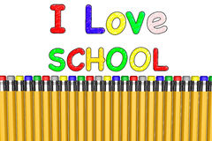 I Love school with pencils. I Love  sign and several pencils with erasers different colors on a white background Royalty Free Stock Photo