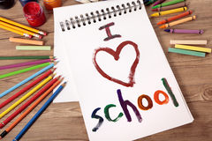 I love school written in a student book on wood desk, back to school concept Royalty Free Stock Photo