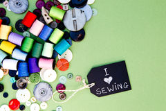 I love Sewing - with blackboard, cotton thread reels and buttons Stock Image
