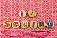 I love sewing spelled in hand painted letters on buttons Royalty Free Stock Photos