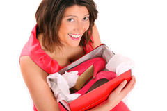 I love shoes!. A picture of a happy woman holding her shoes over white background Royalty Free Stock Image