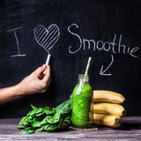 I love smoothie. Fresh green smoothie with banana and spinach with title I love smoothie on blackboard royalty free stock image