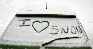 I love snow. Lettering of i love snow on snowy car window royalty free stock photography