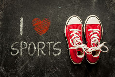 I love sports - poster design. Red sneakers on black. Royalty Free Stock Images