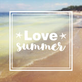 I love Summer quote and lettering on blurred seaside background. Stock Photos