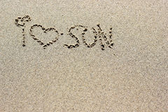 I love sun words written on sand. Beach sand background texture Stock Photos