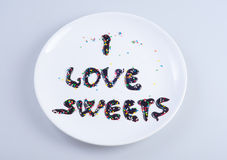 I love sweets written down with liquid chocolate Stock Photo