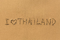 I love Thailand - the inscription by hand on the beach sand. Travel. Royalty Free Stock Image