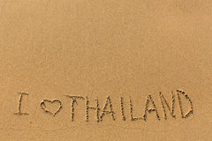 I Love Thailand - manually written in the line of surf sea sand. Abstract. Royalty Free Stock Photo