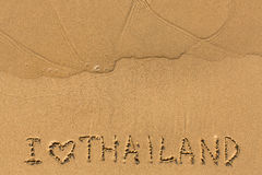 I Love Thailand - text written on sandy beach Royalty Free Stock Images