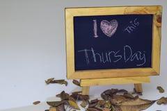 I love Thursday written on a chalkboard. Autumn seasonal flat lay photo on White background royalty free stock photos