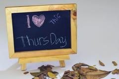 I love Thursday written on a chalkboard. Autumn seasonal flat lay photo on White background.  royalty free stock images