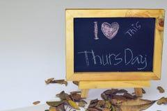 I love Thursday written on a chalkboard. Autumn seasonal flat lay photo on White background.  royalty free stock photography