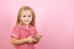 I love to go shopping online. Small shopper use mobile phone. Little girl shopping on smartphone. Little shopaholic. Shopping online. Small girl in e shop stock photography