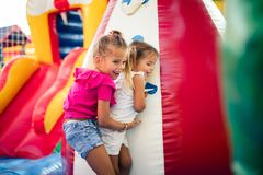 I love to help. Two little girl playing together on playground royalty free stock photos