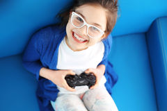 I love to play! Child playing video game Royalty Free Stock Image