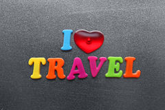 I love travel spelled out using colored fridge magnets Stock Image