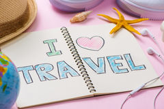 I love Travel written on pen notebook. Vacation Holiday Concept royalty free stock image