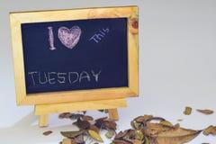 I love Tuesday written on a chalkboard. Autumn seasonal flat lay photo on White background Stock Image