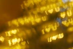 `I love U` bokeh background. Floating `I love U` gold bokeh background vector illustration