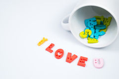 I LOVE U Colorful Letters with White Coffee Cup. For Valentines day Royalty Free Stock Images