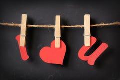 I love u hanging on blackboard. I love u hanging with blackboard background Royalty Free Stock Image
