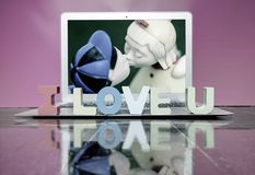 I LOVE U  with woden letters. On a laptop on a wooden floor Stock Photography