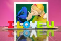 I LOVE U  with woden letters. On a laptop on a wooden floor Royalty Free Stock Photo
