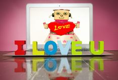 I LOVE U  with woden letters. On a laptop on a wooden floor Stock Photo