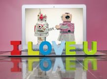 I LOVE U  with woden letters. On a laptop on a wooden floor Royalty Free Stock Images