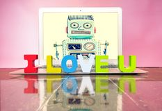 I LOVE U  with woden letters. On a laptop on a wooden floor Royalty Free Stock Photos