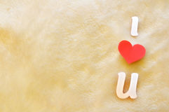 I love u on wool background. Cutout letters i love u on wool background Royalty Free Stock Images