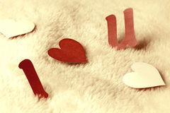 I love u on wool background vintage. Cutout letters i love u on wool background vintage Stock Photography