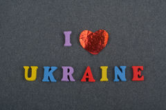 I love UKRAINE word on black board background composed from colorful abc alphabet block wooden letters, copy space for. I love UKRAINIAN word on black board stock photos