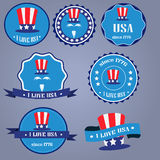 I Love USA badges with uncle Sam hat. On blue background Stock Images