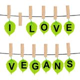 I LOVE VEGANS concept. With green leaves Stock Image