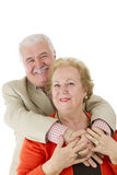 I Love the Way You Hold Me. Older couple showing love each other by holding eachother hands. Man behind the women. Both of them happly smiling happily. Great Royalty Free Stock Photos