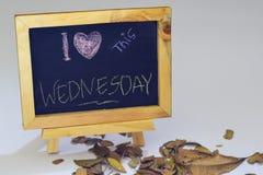 I love Wednesday written on a chalkboard. Autumn seasonal flat lay photo on White background stock photo