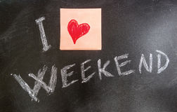 I Love Weekends. Love weekends concept on chalk table whit a red heart Stock Image