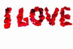 I love - words made of red rose petals. Beautiful romantic backgrounds.  stock photography