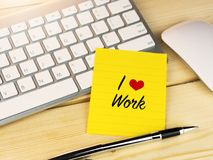 I love work on sticky note on work desk table. Office life and inspiration concept Royalty Free Stock Photos