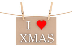I Love Xmas with heart hanging with clothespins Royalty Free Stock Photos