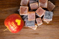 I love yo u apple with sweet marmalade. I love yo u apple with sweet color marmalade sea buckthorn and aronia Stock Image