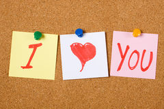 I love You. Written on paper notes pinned at cork board Royalty Free Stock Photos
