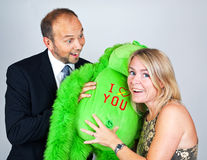 I love you. Couple with a green i love you teddy Royalty Free Stock Photos