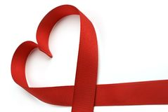I Love You. Closeup image of red ribbon in the shape of a heart royalty free stock images
