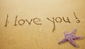 I LOVE YOU. I love  You Written in Sand on Beach with a Starfish Stock Image