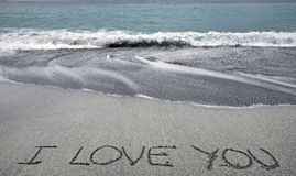 I love you. Written on the sand of a beach stock photos